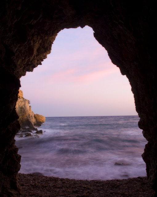 costa blanca tabarca arco en la roca atardecer